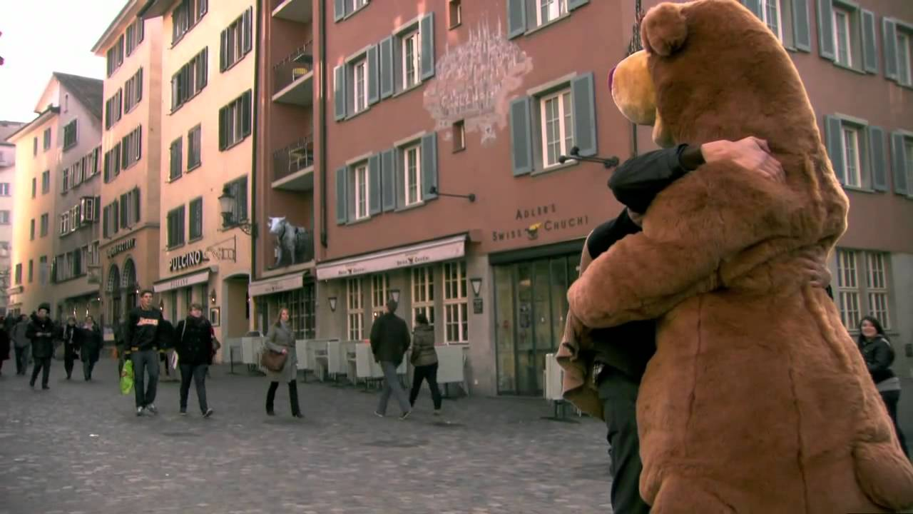 Heartwarming handicapped man wears a costume to give bear hugs to strangers