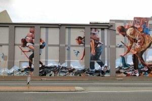 Giant dystopian street murals by Fintan Magee