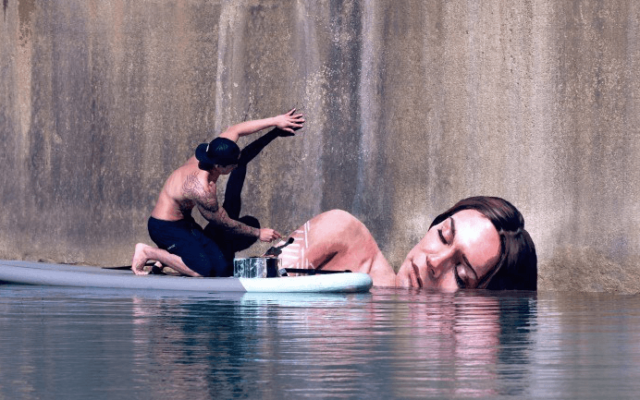 This Guy Paints Stunning Seaside Murals Standing on his Surfboard