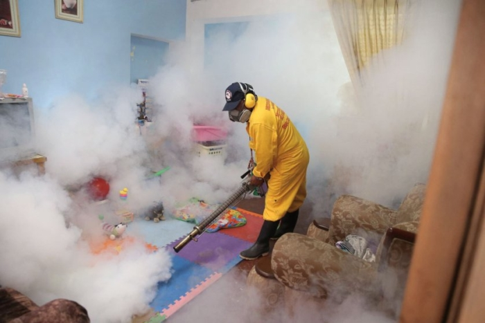An employee conducts fumigation to prevent the Zika virus in the Carabayllo District, Lima Province, Peru, on Jan. 29, 2016. The Health Ministry of Peru held fumigation campaigns to prevent the spreading Zika virus, according to local press.